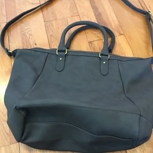 Gray leather look bag.